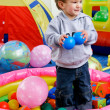 Stock Photo: Happy boy in playing room