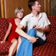Young couple at home during family conflict - Stock Photo