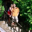 Young attractive couple on stairs of their new house — Stock Photo