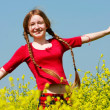 Happy girl in yellow flowers — Stock Photo