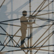 Silhouette of worker at construction site — Stock Photo