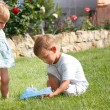 Young brother and sister playing in park — Stock Photo
