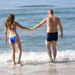 Stock Photo: Young couple entering sea