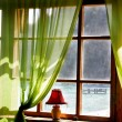Wooden window with sea view in old hotel — Stockfoto