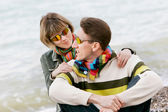 Young couple on sea background — Photo