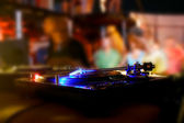 Vinyl disk player in night club — Stock Photo
