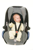 Baby in car seat over white — Stok fotoğraf