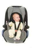 Bebé en el asiento de coche sobre blanco — Foto de Stock