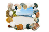 Sand beach in frame from seashells and stones over white — Stock Photo