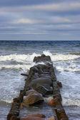 Stone breakwater in winter — Stock Photo