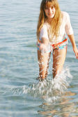 Beatiful girl playing in water drops — Stock Photo