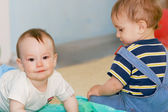 Two baby boys indoors — Stock Photo