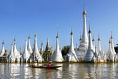 Traditional boat in myanmar on stupa background — Stock Photo