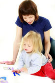 Mother and daughter studing letters, over white — Stock Photo