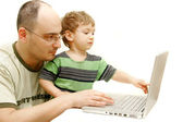 Father and son with laptop over white — Stock Photo