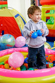 Happy boy in playing room — Stock Photo