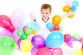 Cute boy playing with colorful ballons over white — Stock Photo