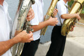 Several musicians with trumpets in a row — Stock Photo
