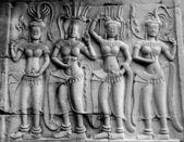 Bailarines de piedra talladas en la pared — Foto de Stock