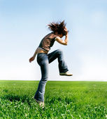 Jumping girl on natural background — Stock Photo