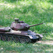 Stock Photo: Toy tank on green grass