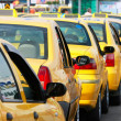 Lots of yellow taxis in the street — Stok fotoğraf
