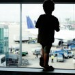 Alone child in airport — Stock Photo