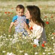 Mother and son in flowers - Stock Photo