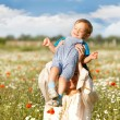 Mother and son on natural background — Stock Photo