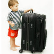 Stock Photo: Young tourist with heavy suitcase