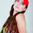 Young girl in red cap looking up — Stock Photo #12611206