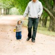 Father and son walking in park — Stock Photo #12611253