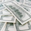 Stock Photo: 100 us dollars banknotes background