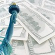 Statue of liberty on 100 us dollars banknotes background - Stock Photo