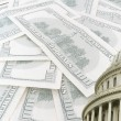 Stock Photo: Us capitol on 100 us dollars banknotes background
