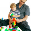 Father and son playing with construction set — Stock Photo