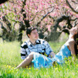 Happy couple in spring garden — Stock Photo
