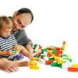 Fahter and son playing with construction set — Stock Photo #12611504