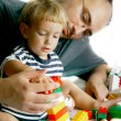 Playing father and son over white - Stock Photo