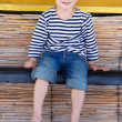 Happy young boy sitting in beach bar — Stock Photo #12611546