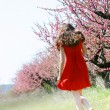 Young girl in spring garden — Stock Photo