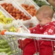 Baby in supermarket - Photo
