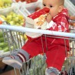Baby in supermarket - Stock Photo