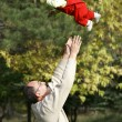 Young father playing with his son - Stock Photo