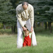 Father and son walking in park — Stock Photo #12611775