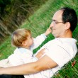 Stock Photo: Father and son outdoors