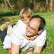 Father and son outdoor portrait - Stock Photo