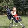 Smiling baby boy in stroller — Stock Photo