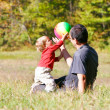 Stock Photo: Father playing with son outdoors