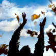 Man throwing up leaves in autumn park — Stock Photo #12612572